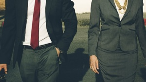 A man and women in work attire walking