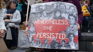 Protest sign reading: Nevertheless, she persisted