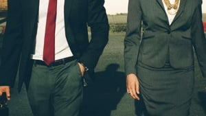 A woman and man in business attire