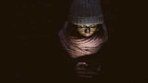 Woman checking her phone in the dark