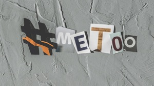 #metoo in cut up writing on grey background