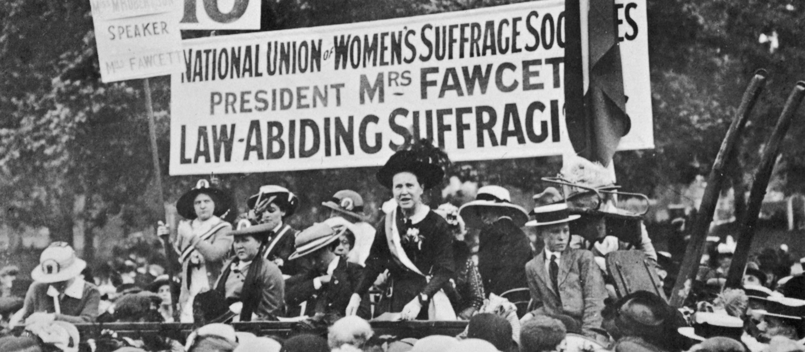 Millicent Fawcett giving a speech in Hyde Park with womens rights activists