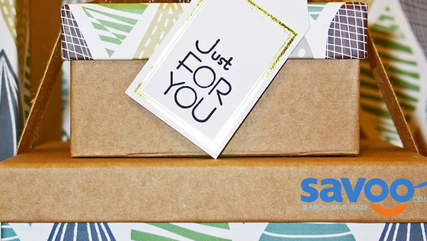A pile of brown paper boxes with Savoo logo printed on one