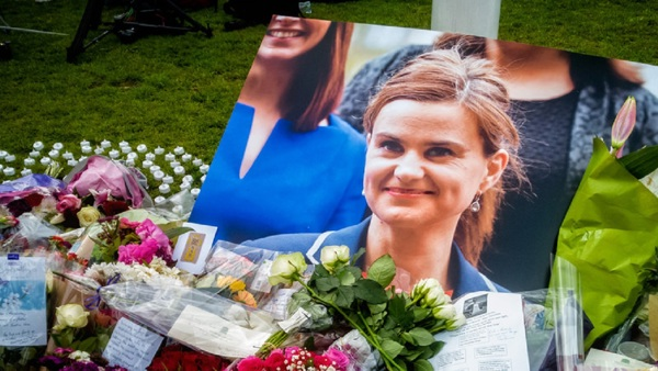 A picture of Jo Cox by a flower memorial