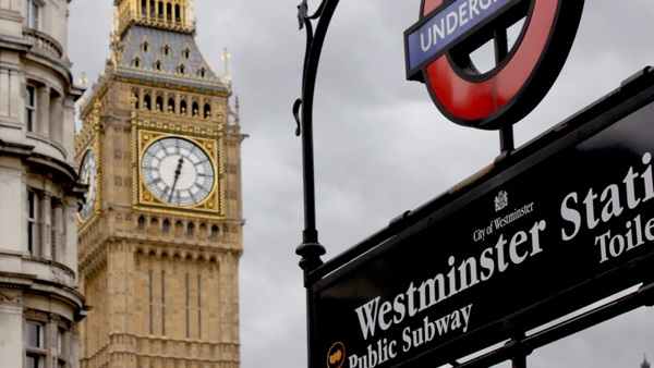 Westminster underground sign with Big Ben in background
